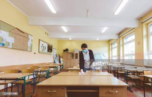 covid-19 the teacher wipes down school tables at  classroom - cleaner stock pictures, royalty-free photos & images