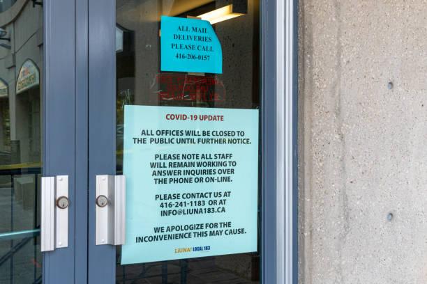 Covid-19 Update Sign in Door, Toronto, Canada