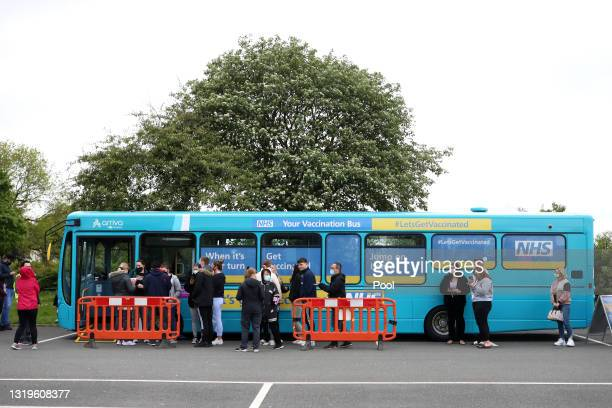 Covid-19 vaccination bus is seen outside the stadium prior to the Premier League match between Liverpool and Crystal Palace at Anfield on May 23,...