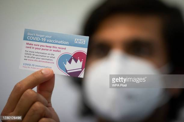 Covid-19 vaccination card after a patient had a dose of the Pfizer/BioNtech covid-19 vaccine at the Hurley Clinic in London, as hundreds of Covid-19...