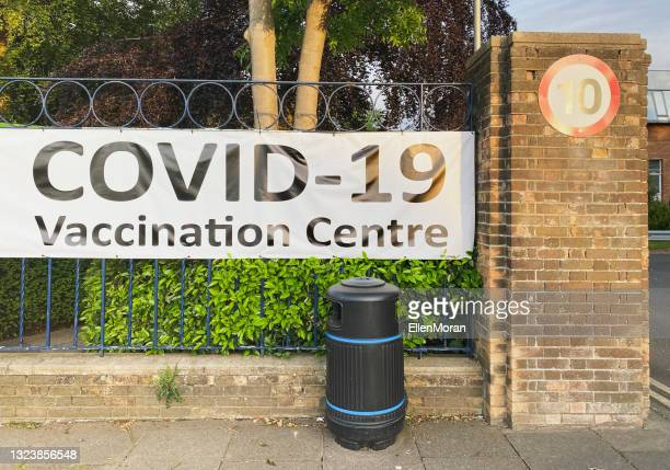 covid-19 vaccination centre - politics and government stock pictures, royalty-free photos & images
