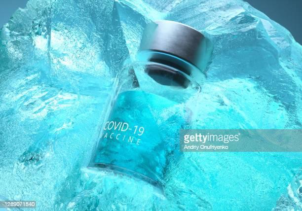 covid-19 vaccine bottle inside ice - verkehrswesen stock-fotos und bilder