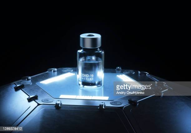 covid-19 vaccine bottle tech - öffentlicher auftritt stock-fotos und bilder