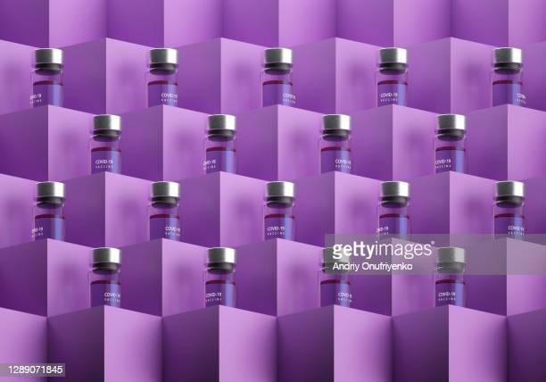 covid-19 vaccine bottles on cubes. - biology stock pictures, royalty-free photos & images