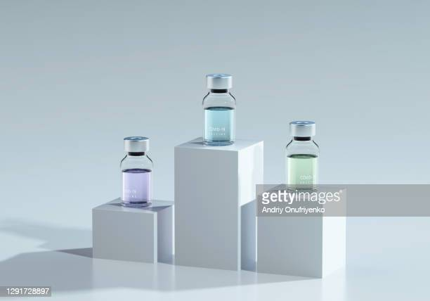 covid-19 vaccine bottles on cubes - award winning stock pictures, royalty-free photos & images