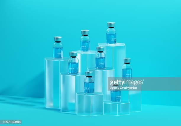 covid-19 vaccine bottles on cubes - wettbewerb unterhaltungsveranstaltung stock-fotos und bilder