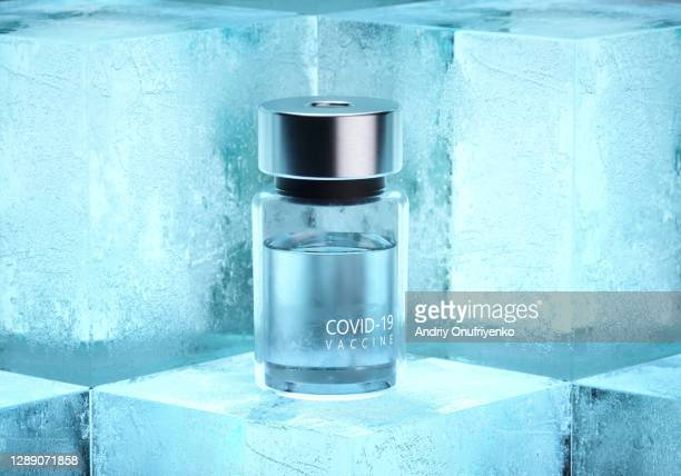 covid-19 vaccine bottles on ice cubes. - covid 19 vaccine stock pictures, royalty-free photos & images