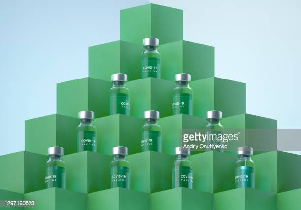 covid-19 vaccine bottles pyramid. - tower stock pictures, royalty-free photos & images