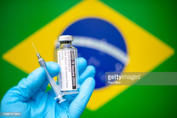 covid-19 vaccine with syringe and brazilian flag image in the background, coronavirus sars-cov-2, vaccination - brazil stock pictures, royalty-free photos & images