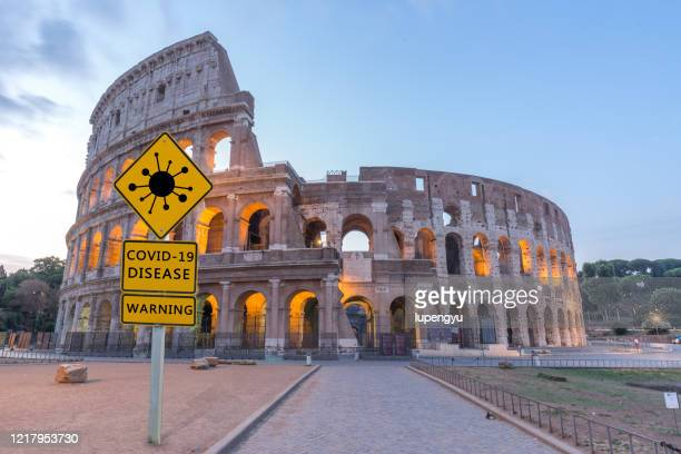 covid-19 warning sign in coliseum,rome - italien bildbanksfoton och bilder
