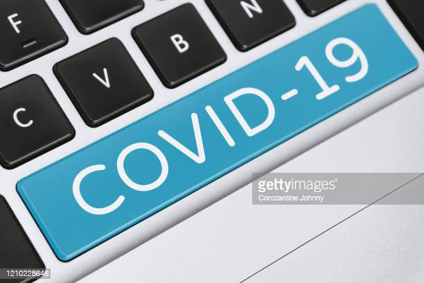 covid-19 word on computer keyboard keys - viral infection stock pictures, royalty-free photos & images