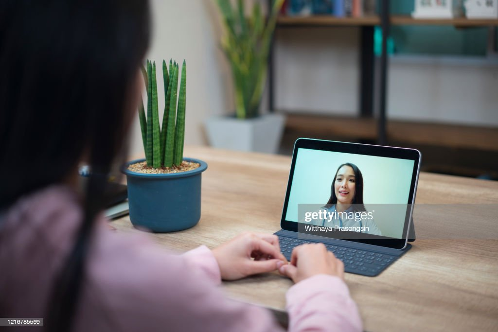 Covid's drainage period, 19 patients who talk to the doctor using a digital tablet Enhancing patient safety against Covid-19 : Stock Photo