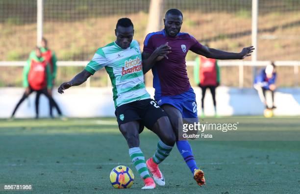 Covilha forward Sodiq Fatai from Nigeria with CD Cova da Piedade midfielder Ballack from Cape Verde in action during the Segunda Liga match between...
