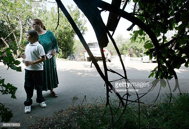 Covina Hills Ca Irene Marquez and her granddaughter Isabell Herrera stand outside their home were authorities discovered a gun in the bushes...