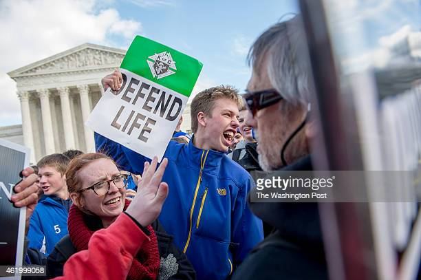 Covington Catholic High School Freshman Tommy Smith of Cincinnati Ohio center screams at a prochoice protesters in front of the US Supreme Court...