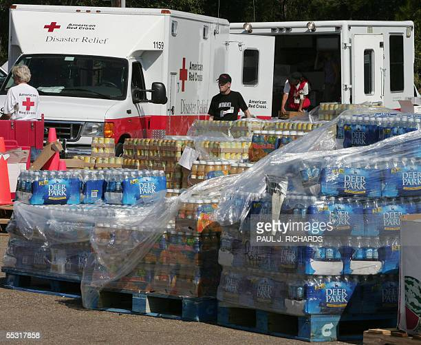 Red Cross trucks load up with relief supplies 08 September 2005 in Covington Louisiana at a Red Cross distribution center in the aftermath of...
