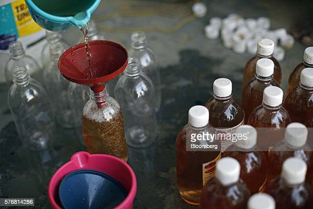 Cow urine is poured into a bottle at a processing facility in Greater Noida Uttar Pradesh India on Friday June 17 2016 Urine from India's indigenous...
