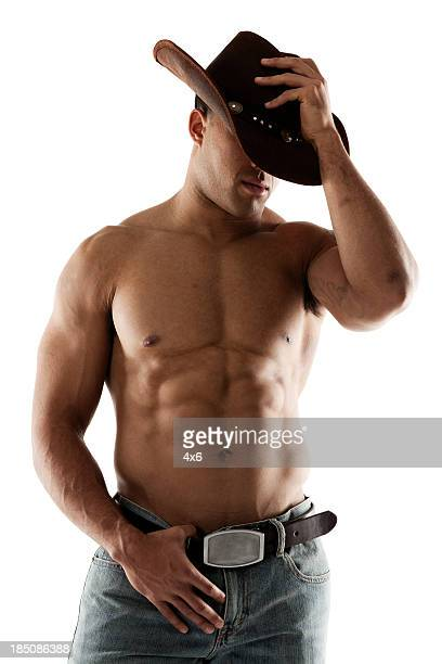 Cowboy adjusting his hat