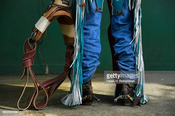 Cowboy and bareback bronc rider Tim O'Connell, of Zwingle, Iowa, shows off his chaps and rigging he poses for a cowboy portrait at the National...