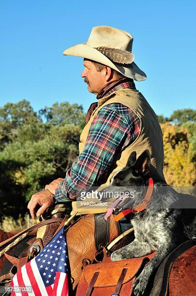 cowboy and his partner - australian cattle dog stock photos and pictures