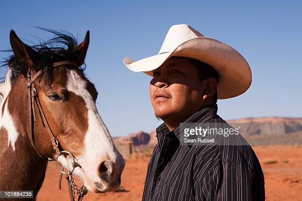 a cowboy and horse, monument valley navajo tribal park, monument valley, utah, usa - native american reservation stock pictures, royalty-free photos & images