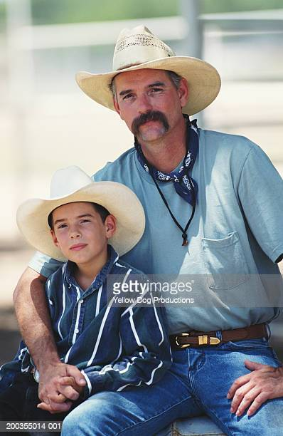 Cowboy and son (7-9), portrait