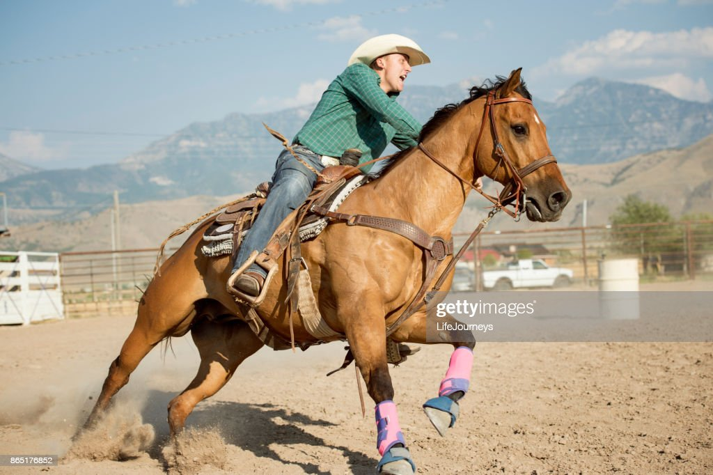 Cowboy Barrel Racing In The Arena At A Local Rodeo High Res Stock Photo Getty Images
