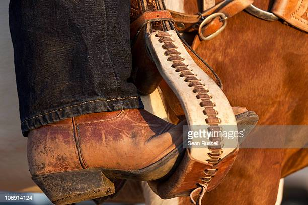 a cowboy boot in a horse stirrup, detail - leather boot stock pictures, royalty-free photos & images