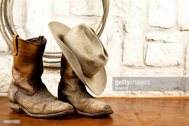 cowboy boots and hat. austin sandstone background - cowboy hat stock pictures, royalty-free photos & images