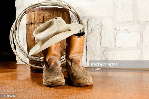 cowboy boots and hat. austin sandstone background - cowboy boot stock pictures, royalty-free photos & images
