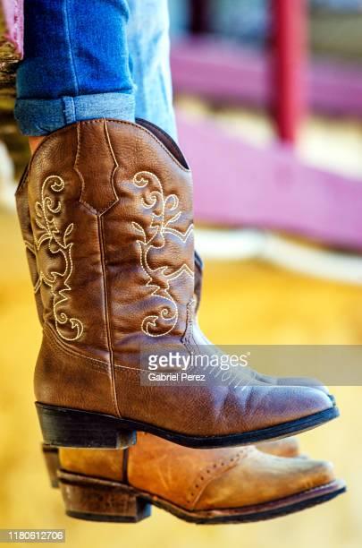 cowboy boots in texas - ブーツイン ストックフォトと画像