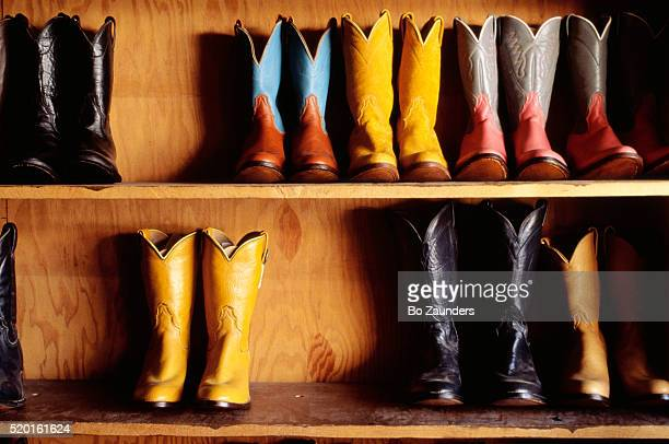 cowboy boots on shelves - bo zaunders stock pictures, royalty-free photos & images