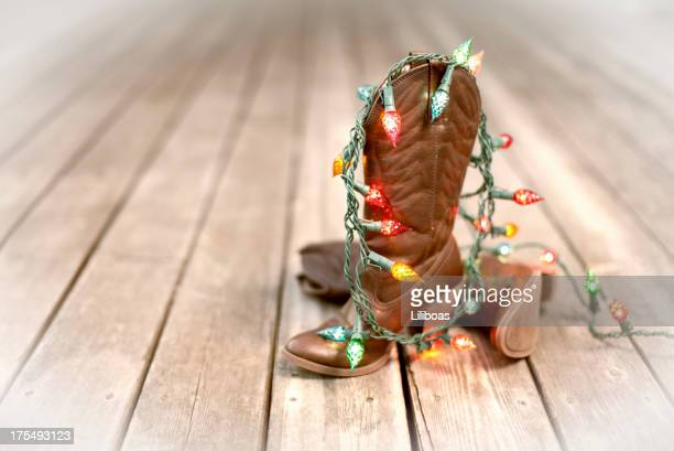 cowboy boots with christmas lights - cowboy christmas stock pictures, royalty-free photos & images