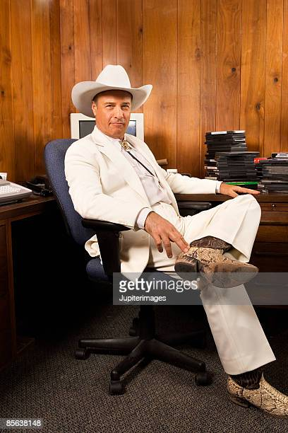 Cowboy businessman in office