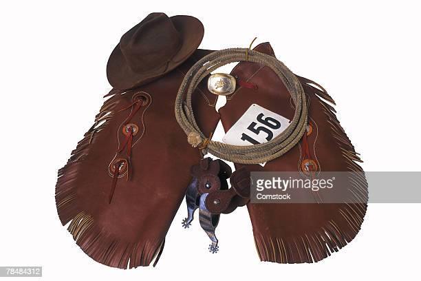 cowboy chaps, hat and lasso - 乗馬ズボン ストックフォトと画像