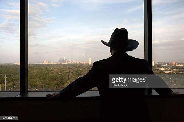 Cowboy executive at window