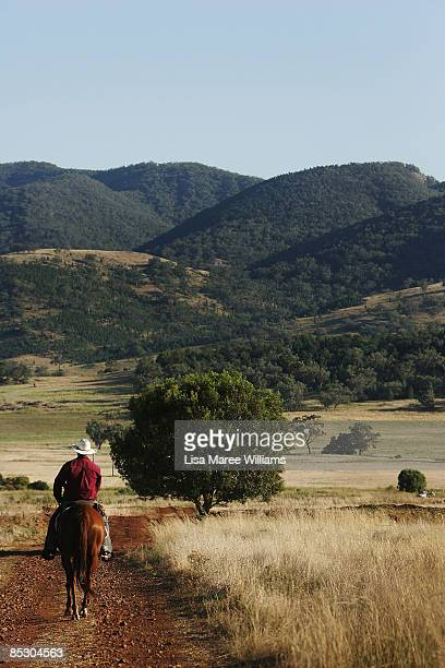 US cowboy Ezra Cooley rides a long a track on a property in Currabubula ahead of attending the Tamworth Country Music Festival on January 17 2009 in...