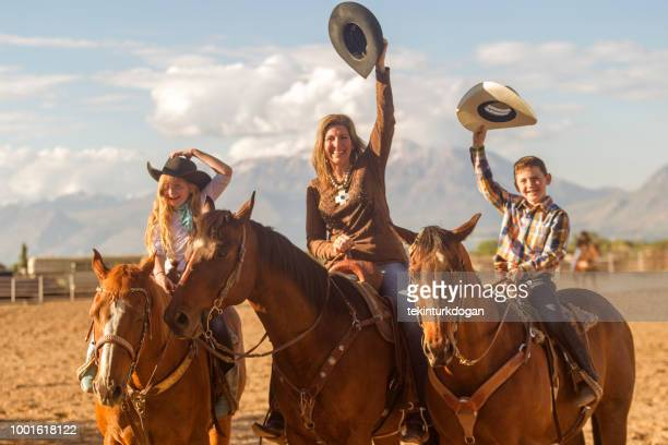 cowboy family mother and children riding horse and salute at santaquin salt lake city slc utah usa - spanish fork utah stock pictures, royalty-free photos & images
