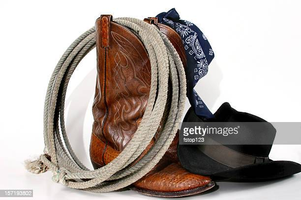 cowboy gear: boots, hat, rope and bandana. isolated on white. - lasso stockfoto's en -beelden