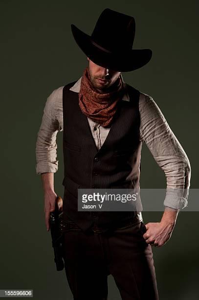Cowboy gunfighter about to take his gun