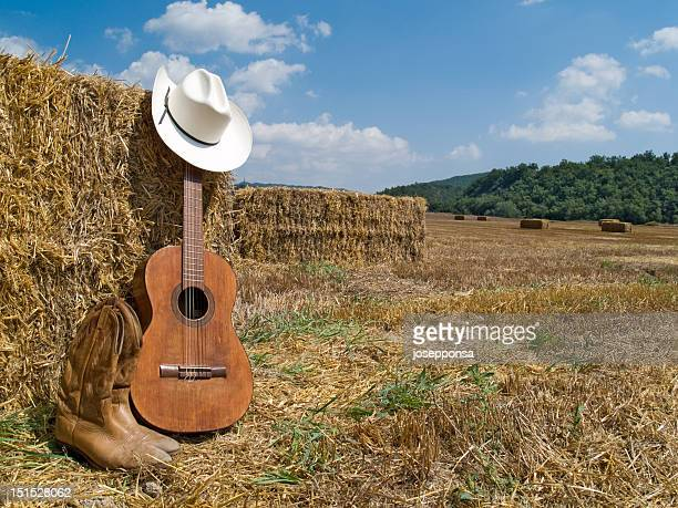 cowboy hat, boots and guitar - cowboy hat stock pictures, royalty-free photos & images