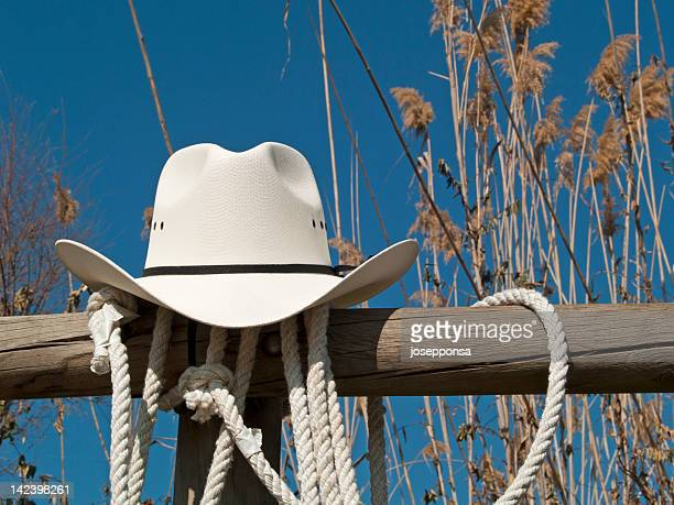 cowboy hat in a fence - cowboy hat stock pictures, royalty-free photos & images