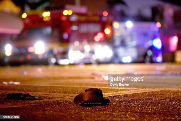 A cowboy hat lies in the street after shots were fired near a country music festival on October 1 2017 in Las Vegas Nevada A gunman has opened fire...