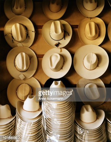 Cowboy Hats Hanging On Wall And In Piles Stock Photo