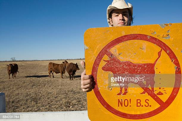Cowboy Holding a Humorous Sign