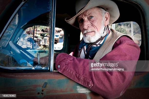 cowboy in an old truck - old truck stock pictures, royalty-free photos & images