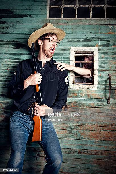 cowboy jailer attacked by prisoner - prison guard stock pictures, royalty-free photos & images