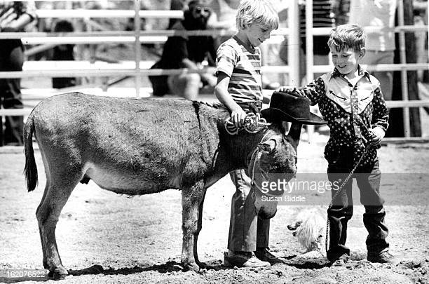 JUL 31 1983 AUG 1 1983 Cowboy Jake Huffstetler right and his poodle Fancy were at the Pet Parade at the Summit County Fair Sat in Silverthorne There...