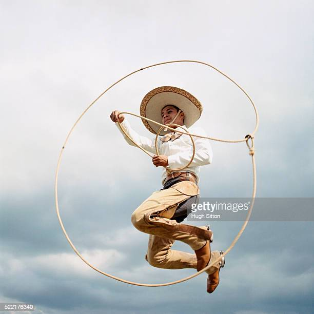 cowboy jumping with lasso - hugh sitton stock pictures, royalty-free photos & images