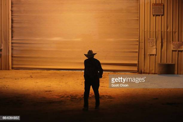 A cowboy leaves the arena following a day of competition at the Bill Pickett Invitational Rodeo on April 1 2017 in Memphis Tennessee The Bill Pickett...